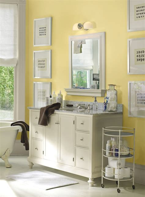 soft yellow bathroom painting artworks painted walls and cabinets