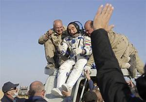 Russian space agency rescue team members help Russian ...