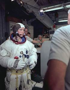Anna Fisher dressed in an Apollo space suit for neutral ...
