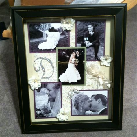 our wedding shadow box i made up of photos my garter my