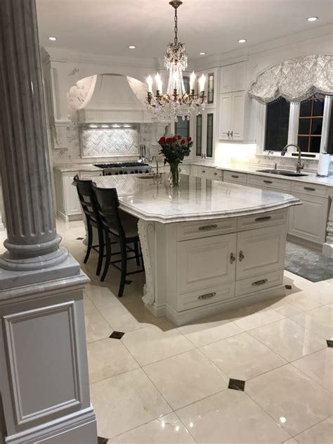 Grand kitchen with Taj Mahal quartzite countertops   RAI