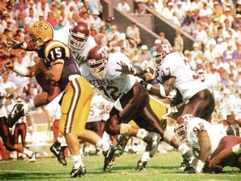The LSU quarterback is swarmed by the Aggie