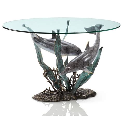 This exquisite glass top coffee end table features a design of a pair of dolphins jumping out of the ocean. Dolphin Duet Coffee Table - Beach Décor Shop