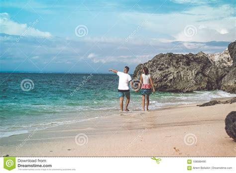 Happy Young Honeymoon Couple Walking On The Beach Ocean