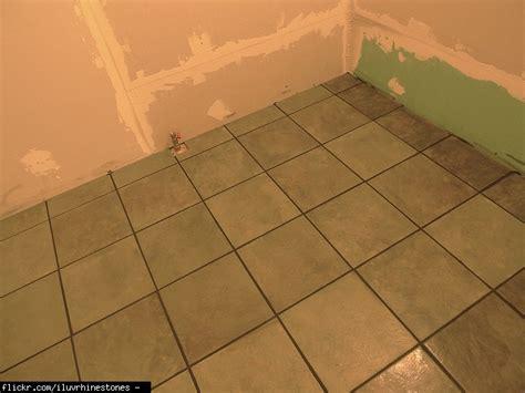 labor cost installation of tile subfloor carpet square