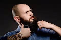 glatze und vollbart einfach attraktiv muscular bald with a beard holding a razor stock photo image of expression 51824146