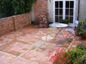 patio constructed from reclaimed bricks and clay tiles