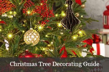 wrapping trees  christmas lights