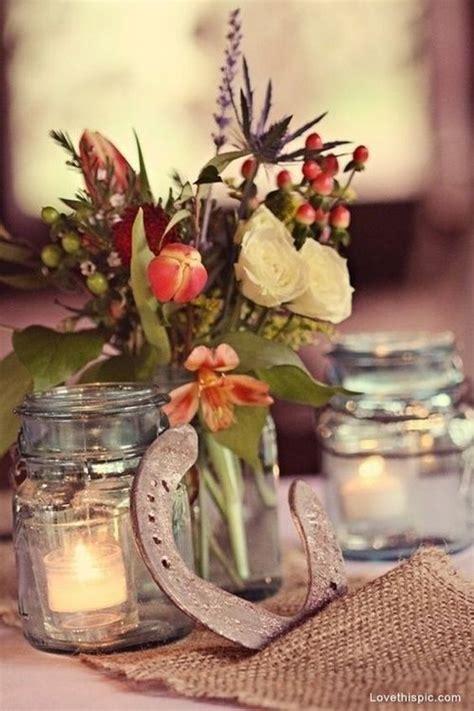 wedding horseshoe rustic farm mason jars centerpiece flowers burlap styling
