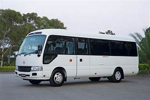 Toyota Coaster bus gets more car-like with update - photos