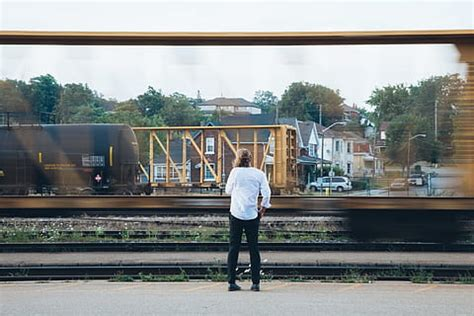 person, capturing, photo, moving, train, railroad, daytime ...