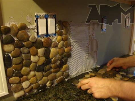 installing river pebble backsplash