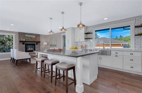White Shaker Cabinets With Concrete Countertops In