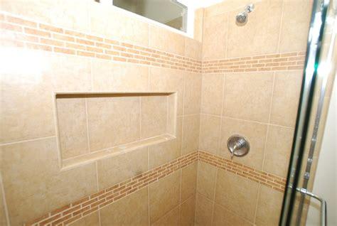 sink vanity with porcelain tile shower recessed