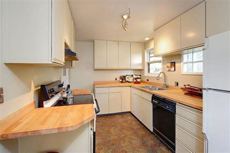 can you paint laminate cabinets what is the best way to use appliance paint on laminated