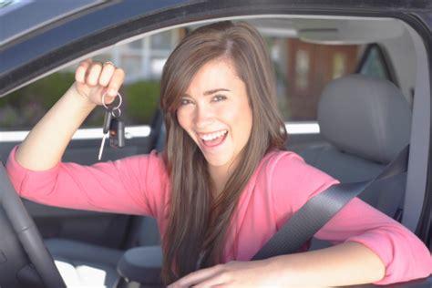 Smiling Teenage Girl Holding Keys Inside Car Stock Photo