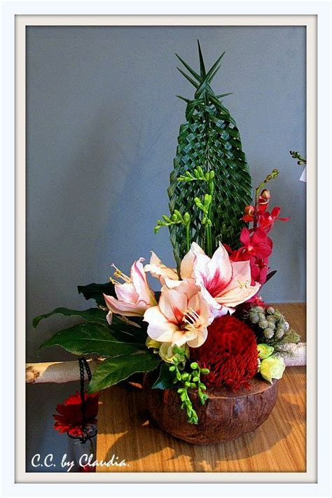 exotic flower arrangement   coconut shell base
