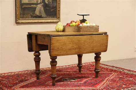 sold english country pine  antique dropleaf console