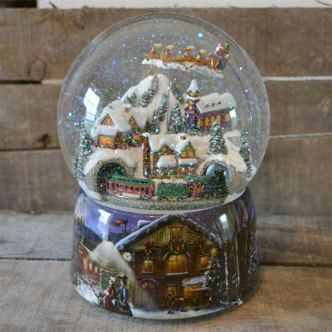 large snow globes christmas large flying santa musical snow globe no 49001 barretts of woodbridge