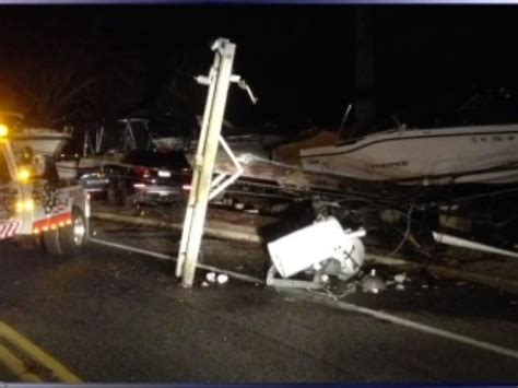 car hits pole boat  toms river woman charged