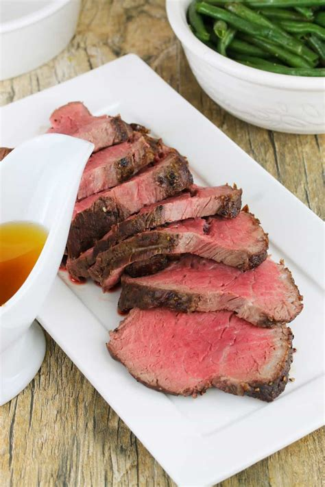 This link is to an external site that may or may not meet accessibility guidelines. Roasted Beef Tenderloin with Garlic Brown Butter Sauce - thestayathomechef.com