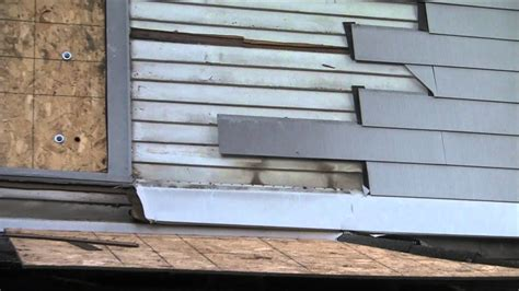 removing  asbestos clapboard siding  duct taping