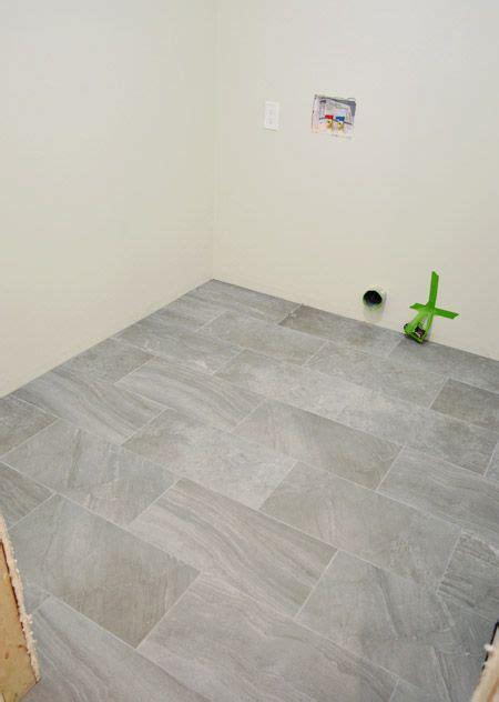 Laying Floor Tile In Bathroom by Laying Porcelain Tile In The Laundry Room For The Home