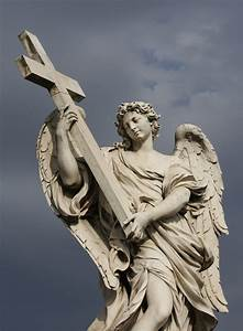 A statue of an angel carrying Christ's cross is seen on ...