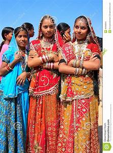 Young Women In Traditional Dress Taking Part In Desert ...