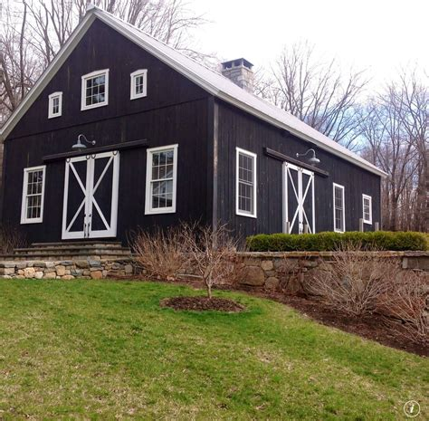 Barn With Black Trim by Black Barn White Trim With Field Rock Fence Black Barns