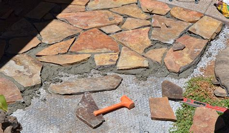 putting in a flagstone patio is like a building a jigsaw