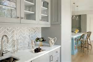 herringbone kitchen backsplash butler 39 s pantry with herringbone backsplash and gray glass front shaker cabinets contemporary
