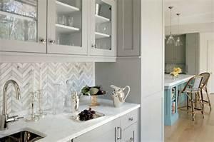 Butler's pantry with herringbone backsplash and gray glass