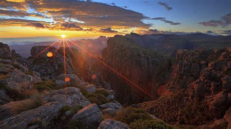 sunset rays dark red cloud canyon rock hd wallpaper