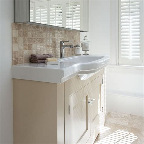 Bathroom with cream and white vanity unit   Decorating