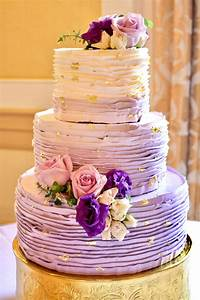 Purple ombré ruffled buttercream wedding cake with gold ...