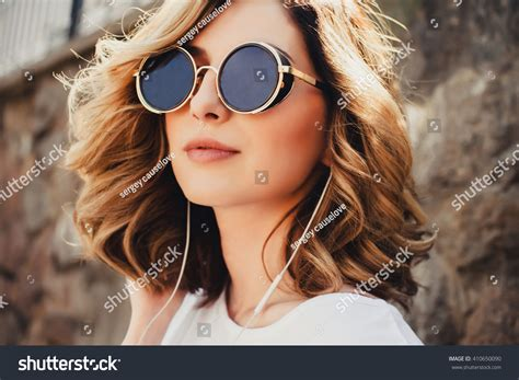Young Girl Hipster Posing Street Listening Stock Photo