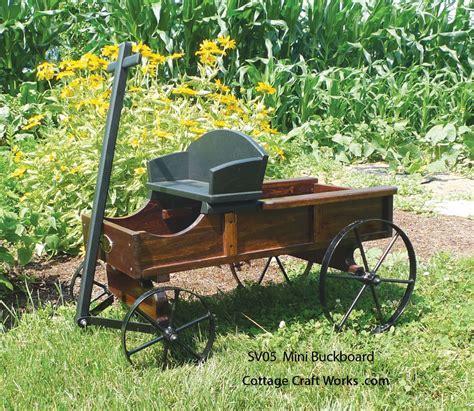 A miniature replica of a buckboard wagon, garden decor planter
