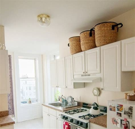 baskets on top of kitchen cabinets decorating above white kitchen cabinets decolover net 9078