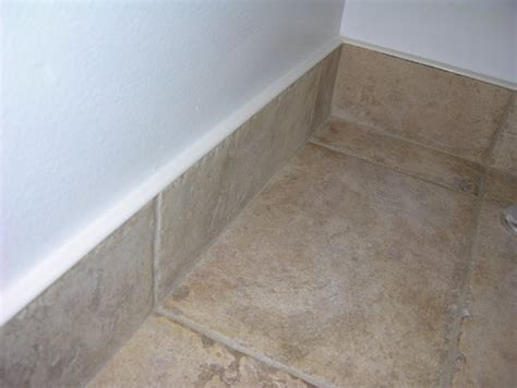 what is the white cap on top of the baseboard tile
