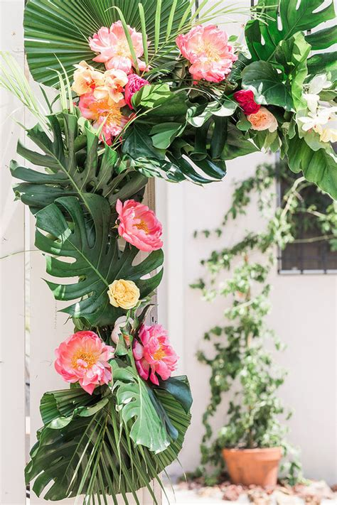 tropical floral arch wedding party ideas  layer cake