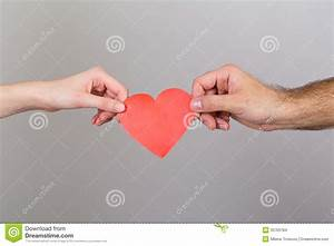 Closeup Of Couple Hands Holding Red Paper Heart Stock ...