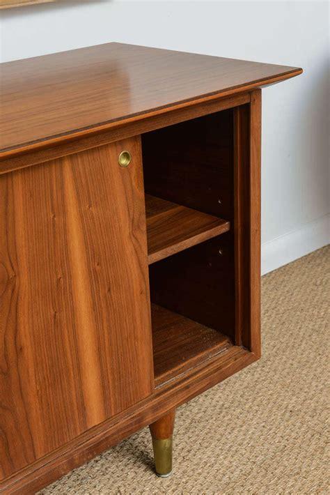 mid century cabinet doors mid century modern walnut sliding door cabinet at 1stdibs