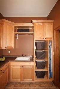 cabinets for laundry room Angie Schwab Interiors: laundry room
