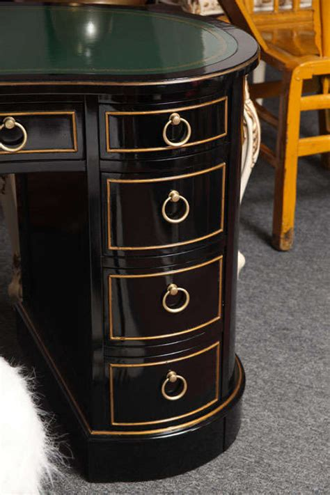 kidney shaped tooled leather top sligh lowry desk and