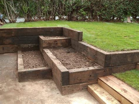 Wood Used For Raised Garden Beds by Garden Landscaping With Railway Sleepers Love The Garden