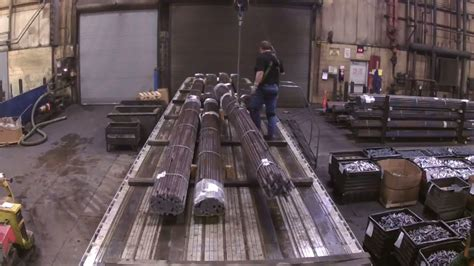 steel truck unloading flatbed rods driver owner