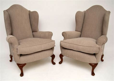 Pair Of Antique Upholstered Wing Armchairs
