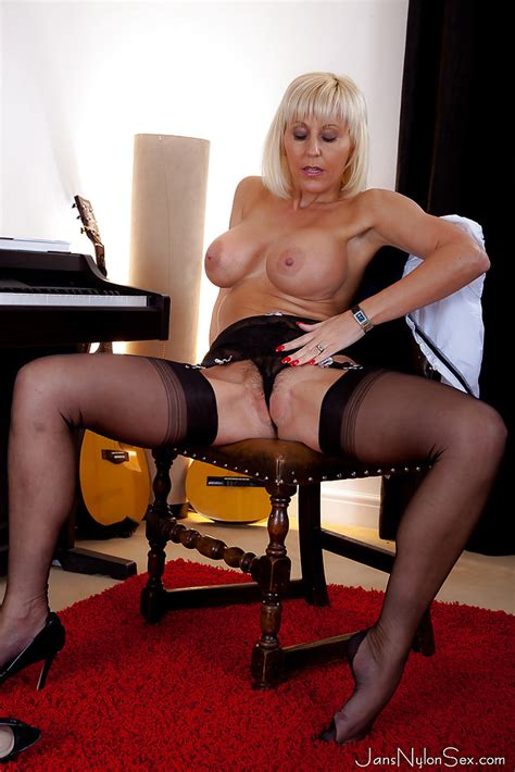 Voluptuous Mature Blonde In Nylons Undressing And Teasing