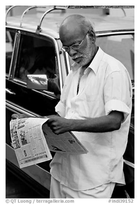 Black and White Picture/Photo: Man reading newspaper next